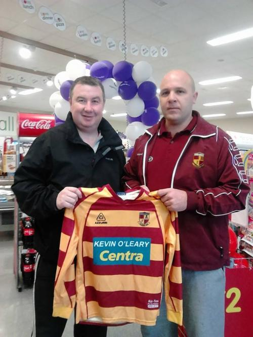 Paul Walsh Centra presenting jerseys to Tony Gubbins