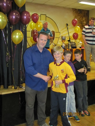 U12 D2 Top Scorer Eoin O' Donovan with Adrian Doyle, Manager image
